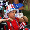 LEANDRA BEABOUT | THE GOSHEN NEWS<br /> Deaven Churchill, 4, Nappanee, tries to beat the heat before the Fourth of July parade downtown.