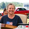 LEANDRA BEABOUT | THE GOSHEN NEWS<br /> Laurie Mast sits in the shade of a tent at Pla-Mor Campground as she plays music for her family at the Miller reunion.