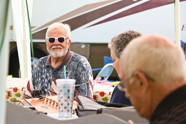 LEANDRA BEABOUT | THE GOSHEN NEWS<br /> Marv Miller smiles as he sits in the shade with his family at the Miller family reunion.
