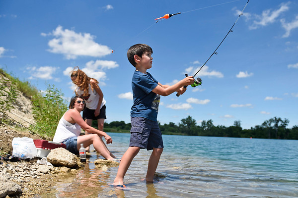 BEN MIKESELL   THE GOSHEN NEWS<br /> Cameron Corvert, 6, from New Castle, Pennsylvania, casts his line into Fidler Pond Monday afternoon while visiting with his aunts, Kim and Kasey Keiper from Goshen. The crew enjoyed the 80-degree weather by catching bass and blue gill for three hours along the shore.