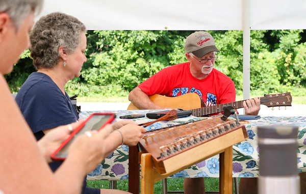 LEANDRA BEABOUT | THE GOSHEN NEWS<br /> Tim Mast plays guitar for his family at the annual Miller reunion.