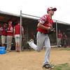 BEN MIKESELL | THE GOSHEN NEWS<br /> Mitch Daniels, 14, runs out to his position in the first inning of the Goshen All-Stars's game against the Mishawaka Cavemen Thursday afternoon on Field 5 at Thelma Schrock Little League Park in Goshen. Thursday's game was the first of five possible round robin games in the next seven days.
