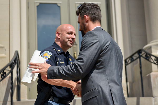 BEN MIKESELL | THE GOSHEN NEWS<br /> Newly appointed police chief José D. Miller shakes hands with mayor Jeremy Stutsman during a press conference Tuesday afternoon outside Goshen City Hall.