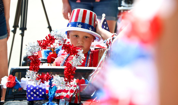 LEANDRA BEABOUT | THE GOSHEN NEWS<br /> Nappanee parade participant Deaven Churchill, 4, isn't sure about sitting in the hot sun as he waits for the parade to begin.