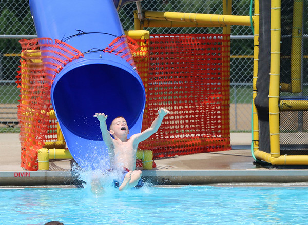 sHEILA SELMAN | THE GOSHEN NEWS<br /> Payton Johnson, Goshen, enjoys a cool splash after sliding through the water tube at Shanklin Pool Sunday afternoon. The pool was full of people trying to get some relief from the 90-plus degree weather while having fun.
