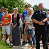 BEN MIKESELL | THE GOSHEN NEWS<br /> People line the sidewalk along 5th Street outside City Hall to listen to mayor Jeremy Stutsman announce Goshen's new police chief Tuesday afternoon.
