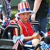 LEANDRA BEABOUT | THE GOSHEN NEWS<br /> Deaven Churchill, 4, Nappanee, sits in the sun while waiting for the Fourth of July parade to begin.