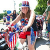LEANDRA BEABOUT | THE GOSHEN NEWS<br /> Nappanee resident Sara Maples, 12, sits and waits in the lineup of Fourth of July parade participants.