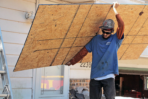 LIZ RIETH | THE GOSHEN NEWS Ruben Ramos was contracted by Builders of Hope to give Melissa Hill's house in Goshen a new roof July 18.