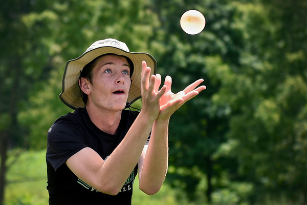 BEN MIKESELL | THE GOSHEN NEWS<br /> Freshman percussion student Zach Pedzinksi attempts to catch a water balloon during Tuesday's water balloon toss between practices at Concord High School's band camp.