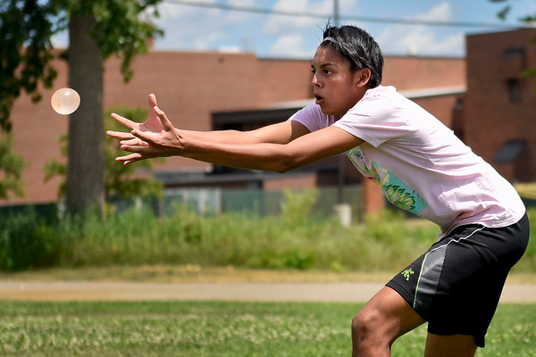 BEN MIKESELL | THE GOSHEN NEWS<br /> Senior clarinet student Gamaliel Montiel attempts to catch a water balloon during Tuesday's water balloon toss between practices at Concord High School's band camp.