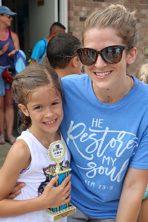 JOHN KLINE | THE GOSHEN NEWS<br /> Shiloh Grubert, 8, left, poses with her mother, Katie Grubert, Union, Michigan, during the 14th annual Kerry's Kids' & Teens' Try-Athlon in Goshen Saturday morning. Shiloh earned a third place trophy in the 7/8 Girls division of Saturday's event.
