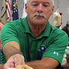 LIZ RIETH | THE GOSHEN NEWS Fair board president Mark Kritzman ate bites from 17 blueberry-filled entries at the Elkhart County 4-H Fair president's baked item contest Thursday.