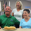 LIZ RIETH | THE GOSHEN NEWS Mark Kritzman, left, his wife Diane and Cheryl Baker pose for a photo. Baker's blueberry cheesecake crumb cake won the Elkhart County 4-H Fair president's baked item contest Thursday.