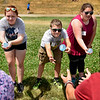 BEN MIKESELL | THE GOSHEN NEWS<br /> Members of the clarinet section in Concord's marching band participate in a water balloon toss activity during band camp Tuesday afternoon at Concord High School. The activity allowed for team-building opportunities and a way to stay cool between practices.