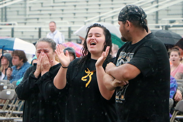 STACEY DIAMOND | THE GOSHEN NEWS<br /> Samantha Corner, left, mom of Army Pfc. Mason corner, reacts as her son steps out onto the Elkhart County 4-H Fair grandstand Saturday night prior to the Daughtry concert. Her family is with her to her right.