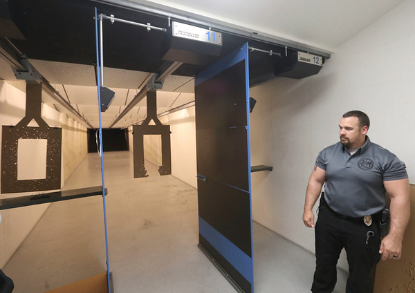 AIMEE AMBROSE | THE GOSHEN NEWS<br /> <br /> Goshen Police Sgt. Jeremy Hooley, training lieutenant with the department, provides a tour of the firing range at the new police training facility, 713 E. Lincoln Ave. The building features 12 firing booths. Work is underway to renovate it and two other buildings, one of which will serve as classroom and office space, on the small campus. The center was dedicated in the name of late Police Chief Wade Branson during a ceremony Wednesday.