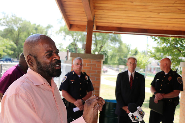 """""""Our biggest fear is that it's going to be one of ours real soon if we don't do something,"""" Rev. Dannell Brown of Agape Missionary Baptist Church tells the audience at a news conference in Elkhart Thursday. With him were Elkhart Mayor Tim Neese, Police Chief Ed Windbigler, Sgt. Travis Snider, department spokesman, and Robert Taylor, president of the Indiana Black Expo Elkhart chapter as they called for more witnesses to come forward and help investigations into a rash of 20 shooting cases in Elkhart since June 28."""