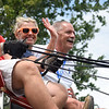 BEN MIKESELL | THE GOSHEN NEWS<br /> Fair president Mark Kritzman and his wife Diane wave to the crowd during the 2018 4-H Fair Parade Sunday in downtown Goshen.