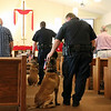 TERRAH HARMON | THE GOSHEN NEWS<br /> Master Trooper Dave Caswell reassures his K-9 companion, Chase, during the blessing service at Richmond United Methodist Church. Photo taken Thursday June 29, 2018.