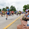 BEN MIKESELL | THE GOSHEN NEWS<br /> Runners participate in the Parade 5000 Road Run before the 4-H Fair Parade Sunday in downtown Goshen.