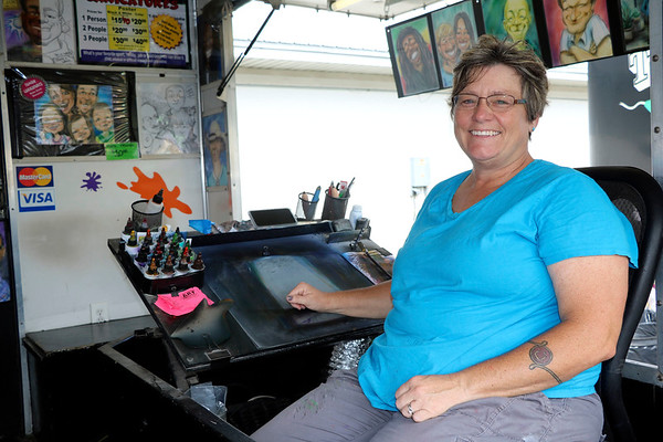 JOHN KLINE | THE GOSHEN NEWS<br /> Caricaturist Teri Peacock has been hawking her wares at the Elkhart County 4-H Fair for almost 20 years.
