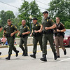 BEN MIKESELL | THE GOSHEN NEWS<br /> Department of Natural Resources officers participate in the Parade 5000 Road Run before the 4-H Fair Parade Sunday in downtown Goshen.