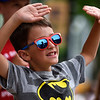 BEN MIKESELL | THE GOSHEN NEWS<br /> Zach Morningstar, 6, Goshen, waves with both hands in hopes of having candy thrown his way during the 2018 4-H Fair Parade Sunday in downtown Goshen.
