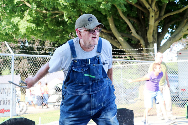 LIZ RIETH   THE GOSHEN NEWS Keith Burger, Syracuse, throws his horseshoe at the Horseshoe Pitching Contest Wednesday.