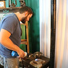 GEOFF LESAR | THE GOSHEN NEWS<br /> Aaron Comino demonstrates heating up metal to make into jewelry at the Elkhart County 4-H Fair.
