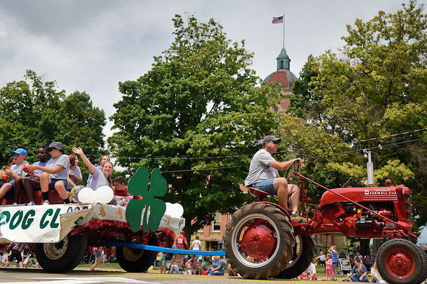 BEN MIKESELL   THE GOSHEN NEWS<br /> The 4-H Dog Club makes its way past the Elkhart County Courthouse on Lincoln Avenue during the 2018 4-H Fair Parade Sunday in downtown Goshen.