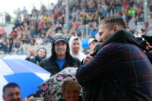 STACEY DIAMOND | THE GOSHEN NEWS<br /> Army Pfc. Mason Corner hugs his mom Samantha Corner in a surprise return home Saturday night at the Elkhart County 4-H Fair grandstands prior to the Daughtry concert.