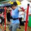 LIZ RIETH | THE GOSHEN NEWS Erick Pineda, Elkhart, holds up weights for the Hercules event in the Elkhart County 4-H Fair Strongman Competition Saturday.