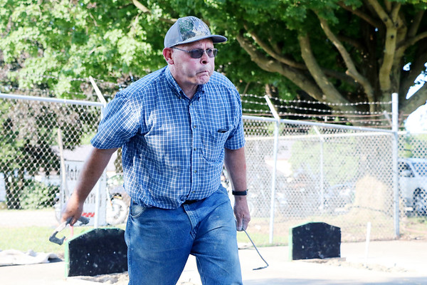LIZ RIETH | THE GOSHEN NEWS Lester Krull, Goshen, purses his lips as he throws a horseshoe for the Horseshoe Pitching Contest Wednesday.