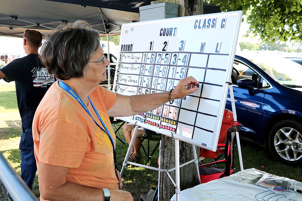 LIZ RIETH | THE GOSHEN NEWS Judy Good, Elkhart County 4-H Fair Horseshoe coordinator, keeps score at the Horseshoe Pitching Contest Wednesday.