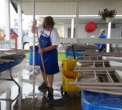 TERRAH HARMON | THE GOSHEN NEWS<br /> Janet Buccione, Goshen, mops the floor on Sunday, July 22, as she prepares for fair goers.