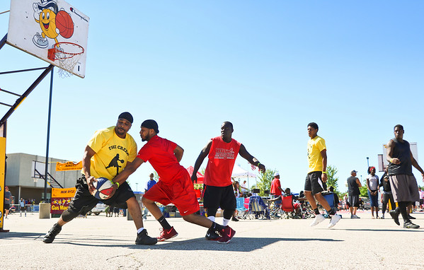 LEANDRA BEABOUT | THE GOSHEN NEWS<br /> A trio of players from Battle Creek, MI, played against a team from Chicago and Peoria, IL, in the Gus Macker tournament Saturday in Elkhart.