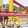 TERRAH HARMON | THE GOSHEN NEWS<br /> A crew of less than 10 sets up Crazy Mouse on Wednesday, June 11.