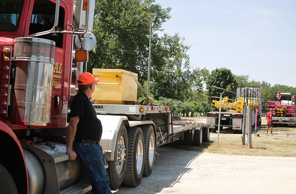 TERRAH HARMON | THE GOSHEN NEWS<br /> George Dockery looks on at the workers setting up the Crazy Mouse on Wednesday, July 11.