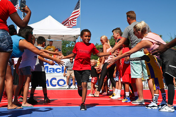 """LEANDRA BEABOUT   THE GOSHEN NEWS<br /> Teams received high fives as they took their places on the """"Dream Court"""" during Saturday's Gus Macker tournament in Elkhart."""