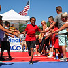 "LEANDRA BEABOUT | THE GOSHEN NEWS<br /> Teams received high fives as they took their places on the ""Dream Court"" during Saturday's Gus Macker tournament in Elkhart."