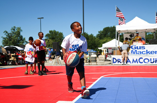 LEANDRA BEABOUT | THE GOSHEN NEWS<br /> Tyren Matthews, 8, takes turns shooting hoops before his team's scheduled game Saturday in the Gus Macker tournament in Elkhart.