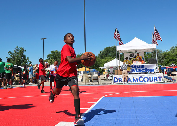 LEANDRA BEABOUT   THE GOSHEN NEWS<br /> Members of a junior team took turns shooting hoops before their scheduled game Saturday in the Gus Macker tournament in Elkhart.