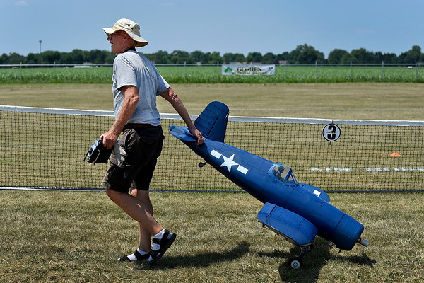 BEN MIKESELL | THE GOSHEN NEWS<br /> Sam Parfitt from West Chester, Ohio, wheels his model Vought F4U Corsair to the runway during a press event Wednesday to promote the Air Supremacy RC show which will run from July 12-14 at the Goshen Municipal Airport.