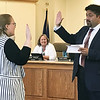 JOHN KLINE | THE GOSHEN NEWS<br /> Goshen School Board President Felipe Merino, right, conducts the swearing-in ceremony for new board member Amanda Qualls, left, during a meeting of the school board Monday evening. Qualls was elected by the board in June to replace former at-large member Jane DeVoe, who announced her resignation May 29.