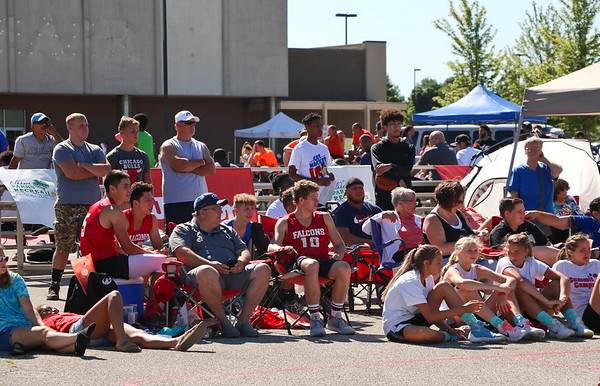 LEANDRA BEABOUT | THE GOSHEN NEWS<br /> Througout the morning and afternoon Saturday, friends and family gathered to support the 90 teams competing in three-on-three basketball during the Gus Macker tournament in Elkhart this weekend.