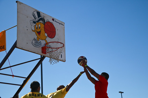 LEANDRA BEABOUT | THE GOSHEN NEWS<br /> Opposing teams vie for the ball at Saturday's Gus Macker tournament in Elkhart.