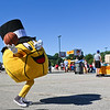 LEANDRA BEABOUT | THE GOSHEN NEWS<br /> During a break on the court, the Gus Macker mascot takes a stab at throwing the ball.