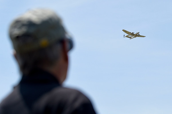 BEN MIKESELL | THE GOSHEN NEWS<br /> Carl Bachhuber, from Mayville, Wisconsin, flies his remote-control aircraft over Goshen Municipal Airport during a press event Wednesday to promote the Air Supremacy RC show which will run from July 12-14.