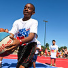 LEANDRA BEABOUT | THE GOSHEN NEWS<br /> Members of a junior team took turns shooting hoops before their scheduled game Saturday in the Gus Macker tournament in Elkhart.